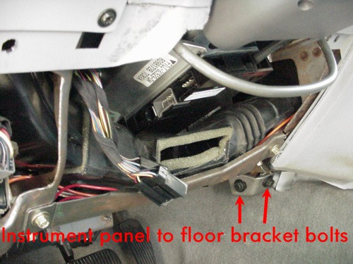 Remove The Two Bolts And The Bracket That Connects The Instrument Panel To The Floor On The Drivers Side Near The Forward Edge Of The Console