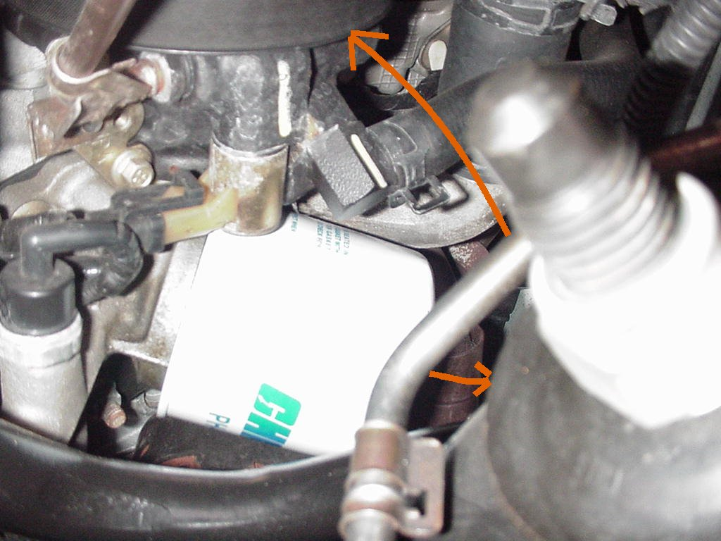 Clean up the spilled oil on the crossmember using a rag or paper towel. Put  a light coat of oil on the rubber gasket of the new filter.